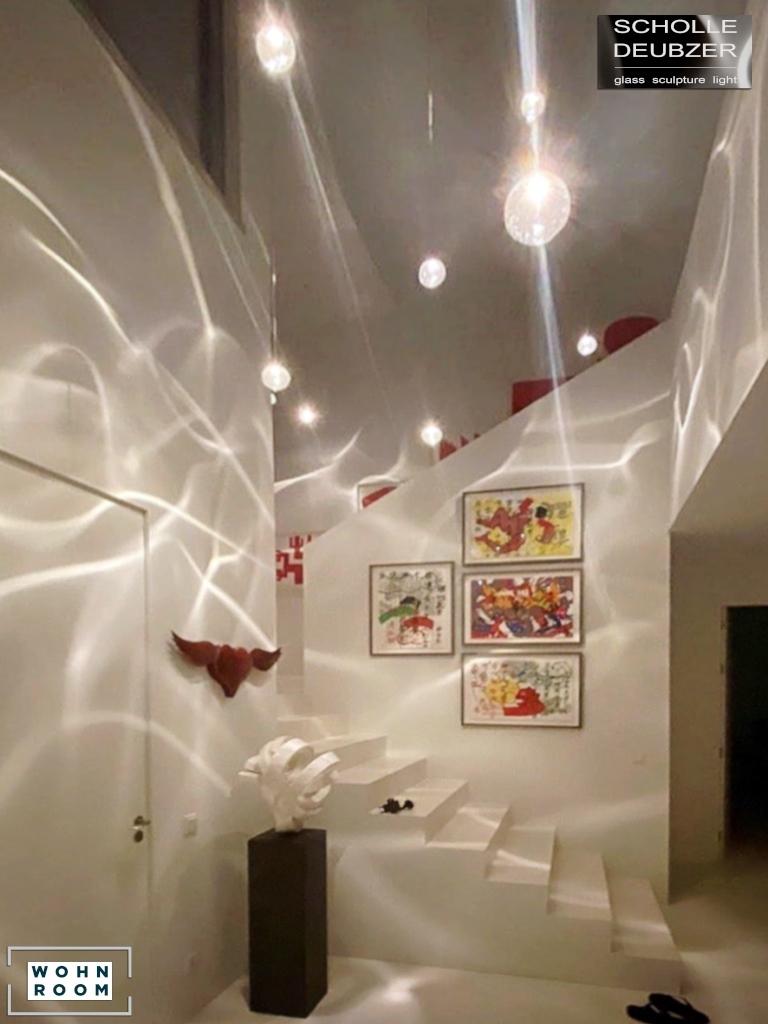 wandverkleidung_licht_drop_scholle_deubzer_wandbeleuchtung_wohn-room